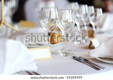 Empty place card on a white festive table - stock photo