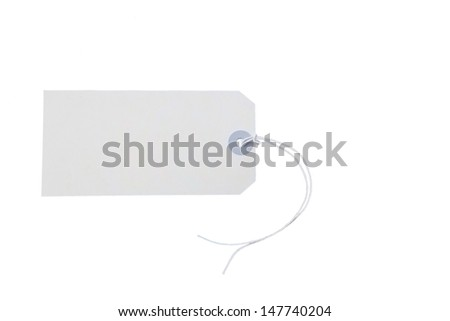 Empty plain white gift tag with a string on white background