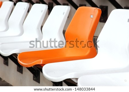 Empty Plastic Chairs at the Stadium - stock photo