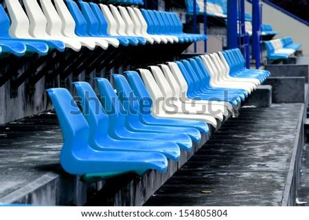 Empty Plastic Chairs at the Stadium - stock photo