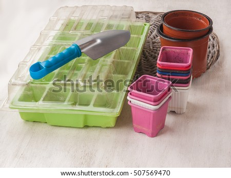 Empty plastic tray with hole for seedlings,  pots, sponge and shovel  after the end of the season