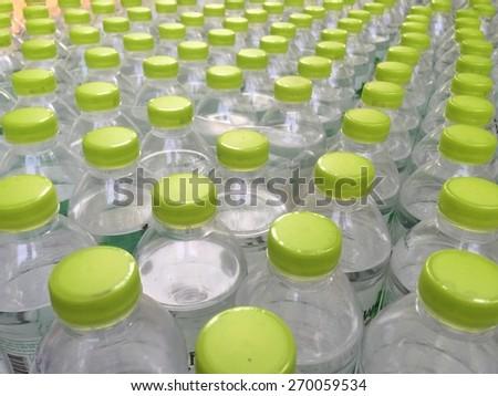 empty plastic water bottle with green cap - stock photo