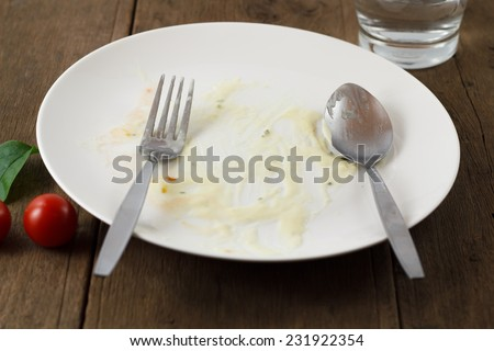 Empty plate after meal - stock photo