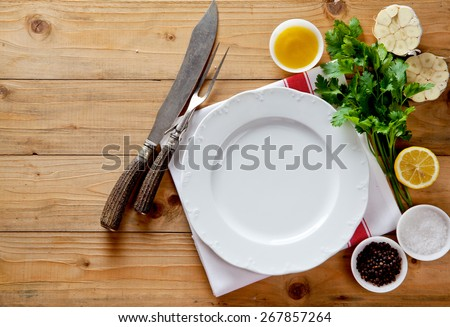 empty plate and carving knife and fork - stock photo