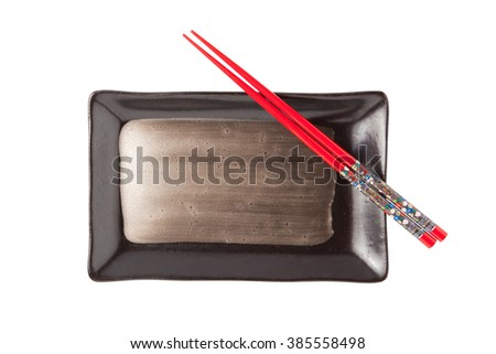Empty plate and chopsticks isolated on white background - stock photo