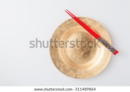 Empty plate and chopsticks. on white background - stock photo