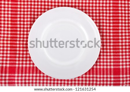 Empty plate at classic checkered tablecloth