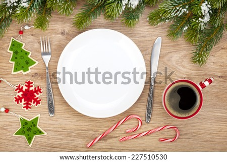 Empty plate, coffee cup and christmas decor. View from above - stock photo