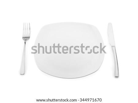 Empty plate, fork and knife on white background