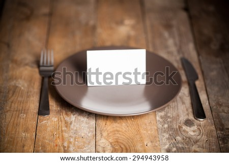 Empty Plate, Fork, Knife on wooden background. Top View with Text Space  - stock photo