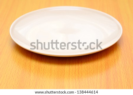 empty plate is on table - stock photo