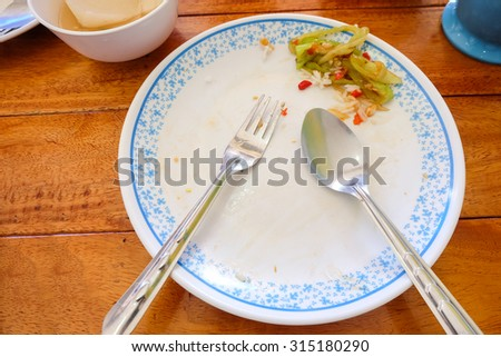 Empty plate left after lunch time / Kid eat finished remove sweet peppers - stock photo