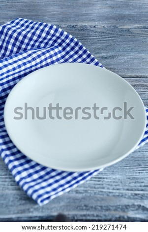 Empty plate on a napkin, top view
