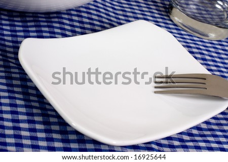 Empty plate on top of a dining table