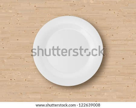 Empty plate on wooden table. - stock photo