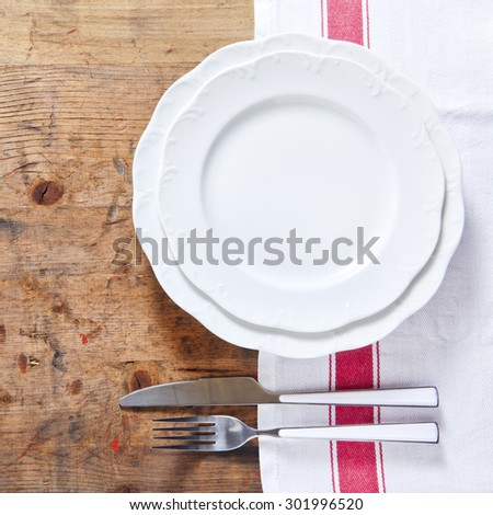 empty plate with cutlery on a wooden background. space for writing or placing text menu - stock photo