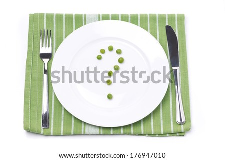 empty plate with green peas in the shape of a question mark, concept, isolated on white - stock photo