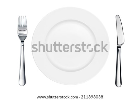 Empty plate with knife and fork - stock photo