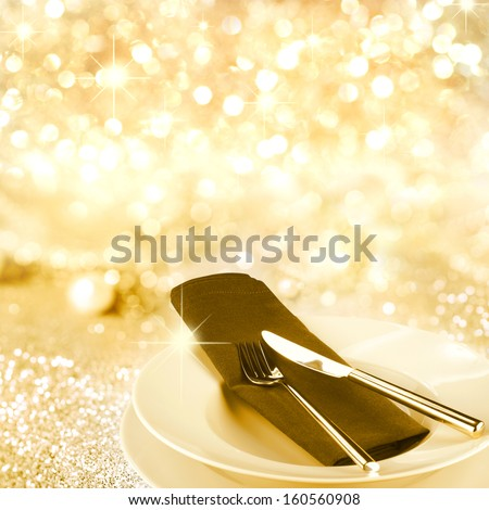 Empty plate with knife and fork on purple background - stock photo