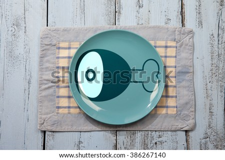 Empty plate with meat icon on light blue wooden background - stock photo