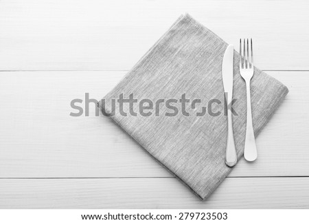 Empty plates and cutlery on table cloth on wooden table for dinner, menu in restaurant Top view horizontally. Flat mock up for design.
