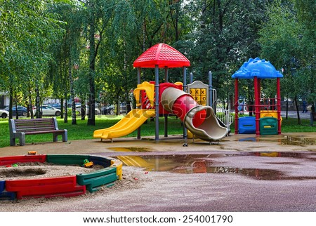 empty Playground in the park after a rain - stock photo