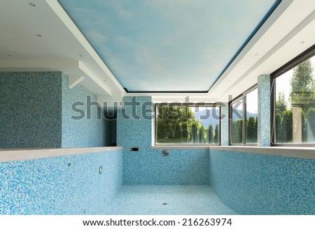 empty pool, interior of a modern villa - stock photo