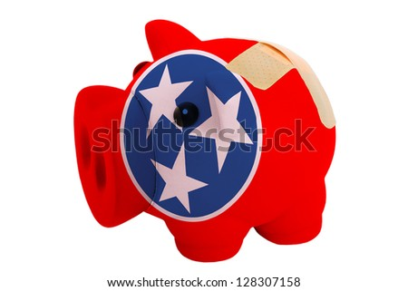 empty poor man piggy rich bank in colors flag of us state of tennessee on white