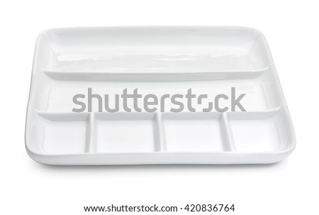 Empty porcelain square compartment dish isolated on a white background - stock photo