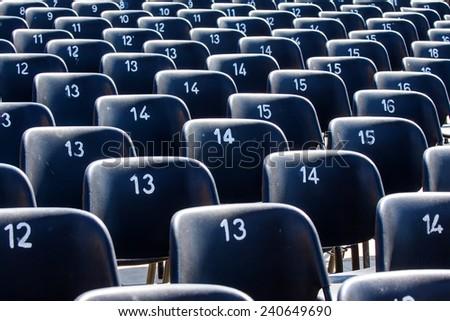 Empty portable plastic chairs  - stock photo