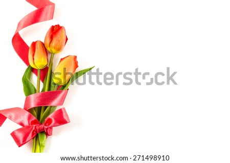 Empty postcard background with colorful flowers and red ribbon - stock photo