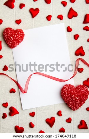 Empty postcard with heart-shaped candles, red ribbon and small f