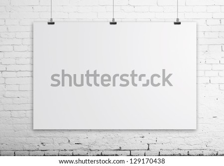 empty poster on brick white wall - stock photo