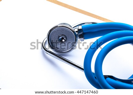 Empty prescription  lying on table with stethoscope