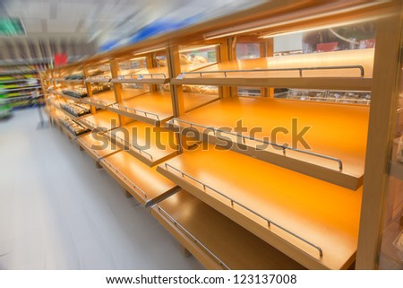 empty product shelf in the super market - stock photo