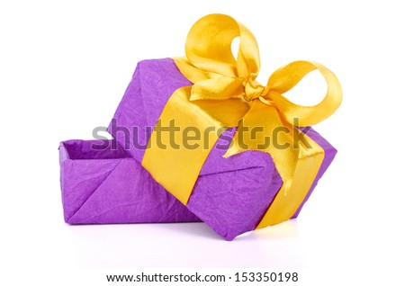 empty purple gift box with golden ribbon on white background.