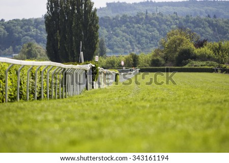 Empty race track for horses, blurred background. Selective focus. - stock photo