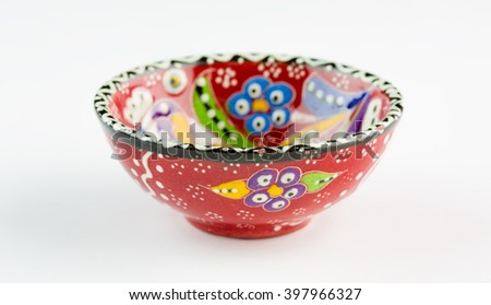 Empty red bowl on a white background