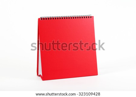 empty red calendar stand cover and pen isolated on white - stock photo