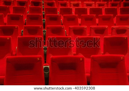 Empty red cinema or theater seats - stock photo