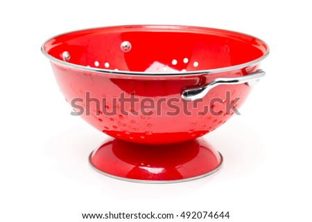 Empty red colander over white background