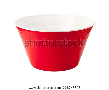 Empty red disposable plastic bowl. These brightly colored containers are a favorite at parties and picnics and are used to serve chips and various other party foods.  - stock photo