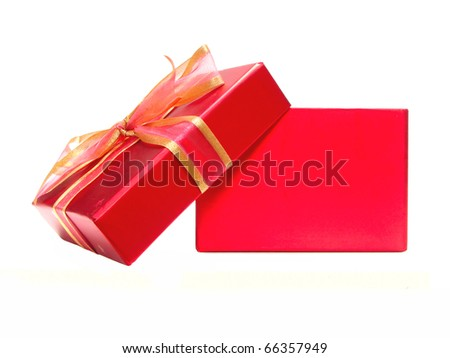 Empty red gift box with lid and bow on a white background - stock photo