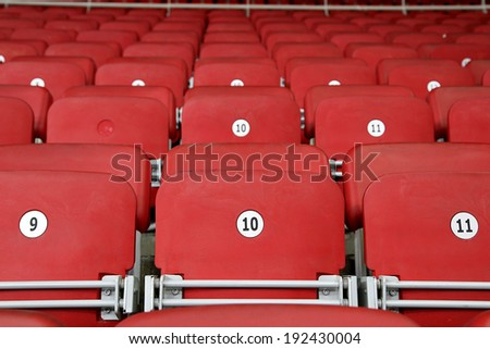 Empty Red Grandstand Stadium Seats - stock photo