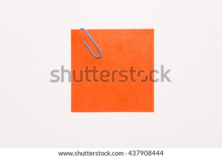 Empty red notepaper with blue paper clip - stock photo