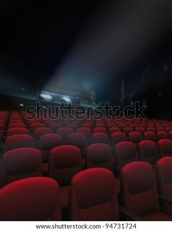 Empty red of seat and rows in cinema with projector lighting - stock photo
