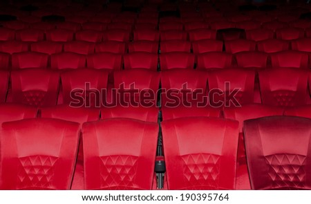 Empty red seats row in thearter - stock photo