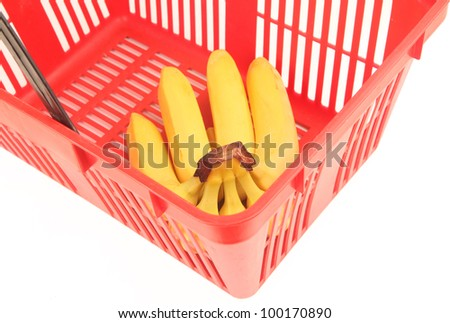 Empty red shopping basket with bananas. Isolated over white background. - stock photo