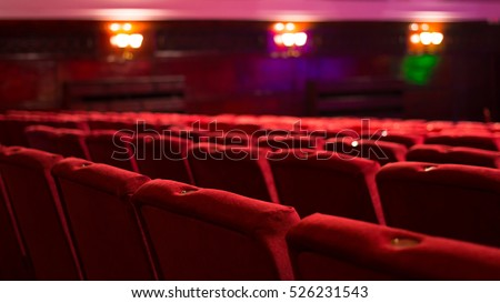 empty red theater chairs