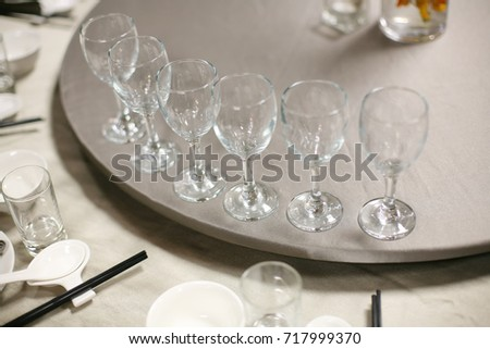 empty red wine cups on round table